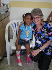Missy Farris with Girl in an Ankle Foot Orthotic