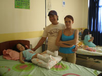 Girl in 2 Leg Casts with Parents